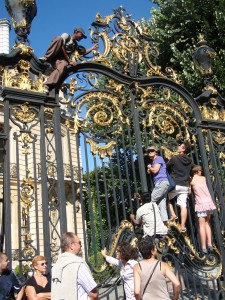 Bastille Parade - people climb on gate