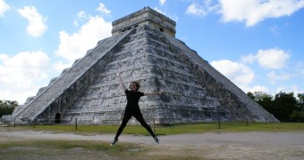 Ashley jumping in Chichen Itza, Yucatán Peninsula, Mexico. © No Onion Extra Pickles.