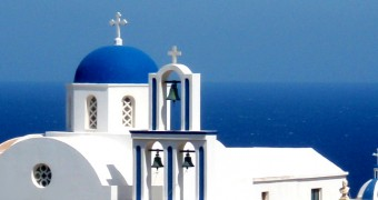 White washed blue domed church of Santorini