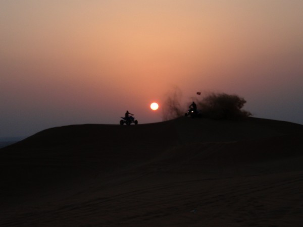 Sunset over sand dune on desert near Dubai, UAE