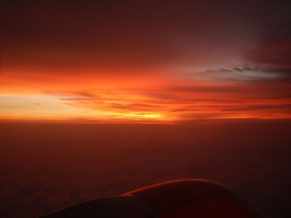 Sunset from the sky above the clouds, during Bali Java flight, Indonesia