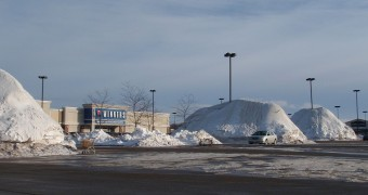 Snow pile at shopping center&#039;s parking lot in our hometown in Canada