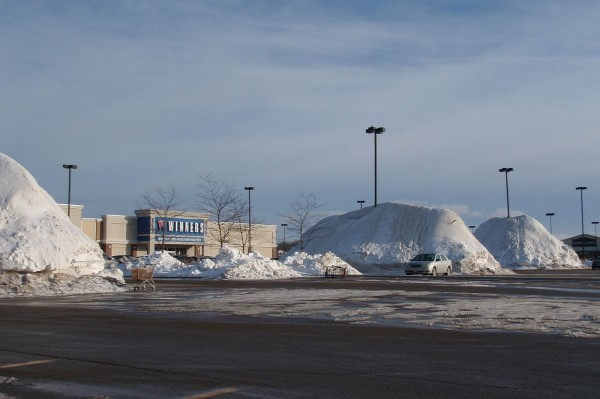 Snow pile at shopping center's parking lot in our hometown in Canada