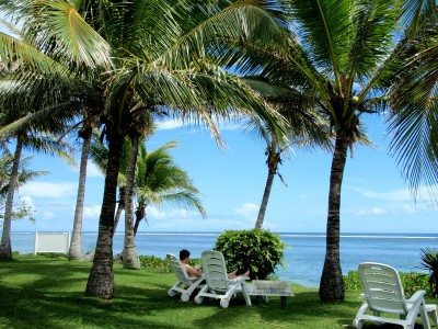 Relaxing under coconut tree overlooking a Fijian lagoon