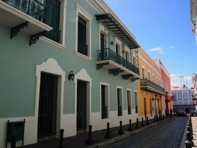 Colorful houses and dark blue cobblestone in Old San Juan, Puerto Rico