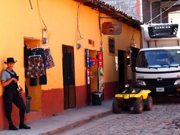 Armed security guard in front of a clothing store in Copan Ruinas, Honduras