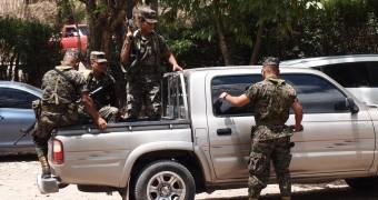 Army with rifles guarding the Mayan ruin Copan, Honduras