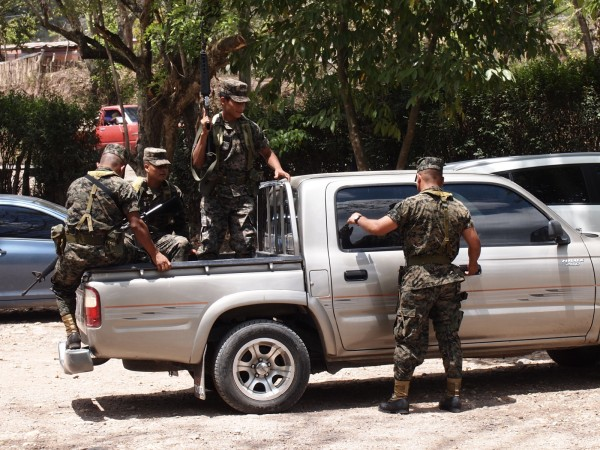 Army with rifles guarding the Mayan ruin Copan, Honduras
