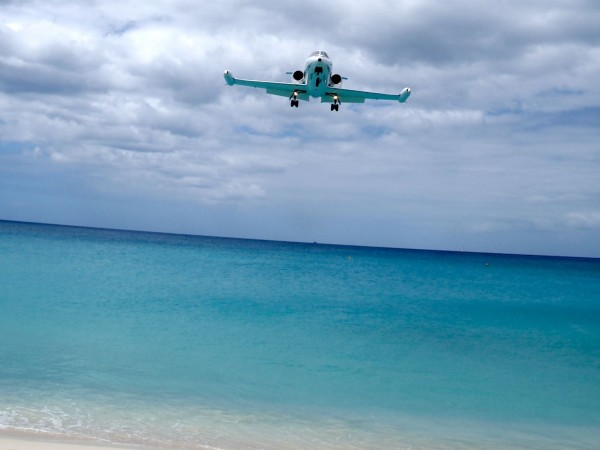 Maho Beach, Sint Maarten, Caribbean: An approaching airplane