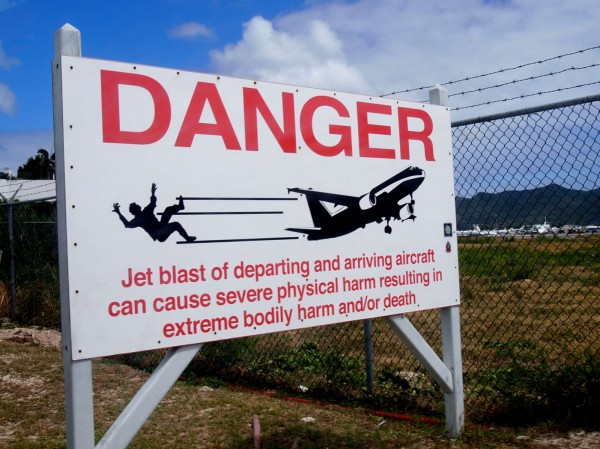 Maho Beach, Sint Maarten, Caribbean: Danger warning sign