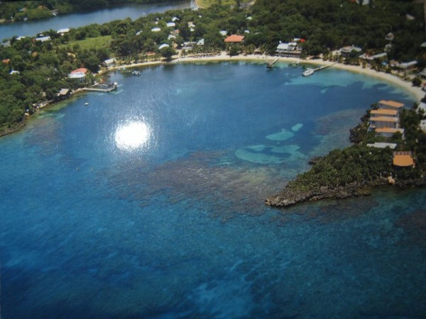 A postcard showing aerial shot of Half Moon Bay, Roatan Island, Honduras
