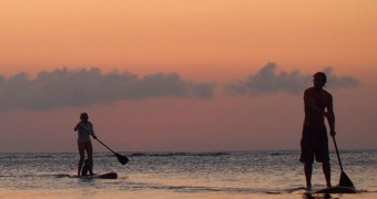 Sunset paddleboarding in Roatan, Honduras