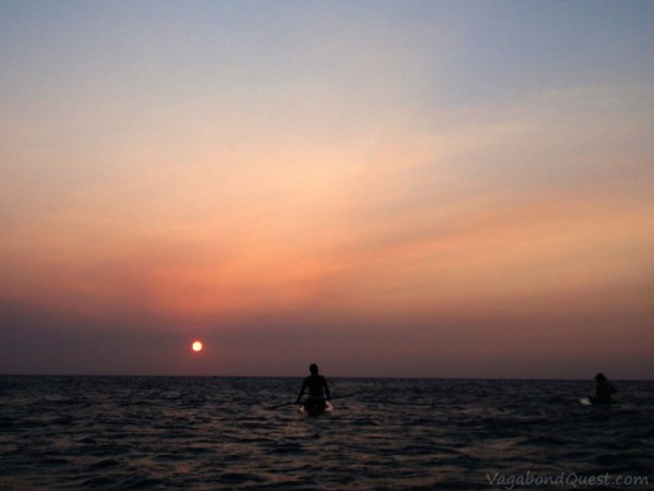Sunset paddleboarding in Half Moon Bay, Roatan Island, Honduras