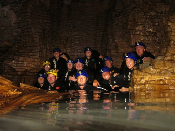 Black water rafting in underground river of the Waitomo glowworm cave, New Zealand
