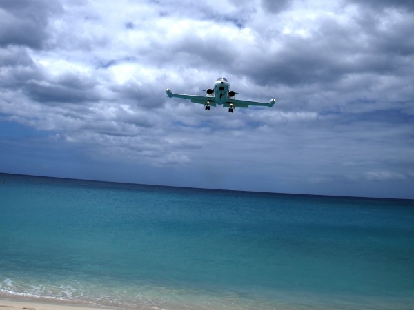 Landing airplanes in Maho Bay Beach, Sint Maarten, Caribbean