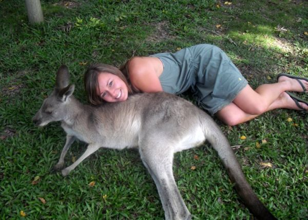 Molly spooning a kangaroo! (Photo © Go Overseas)