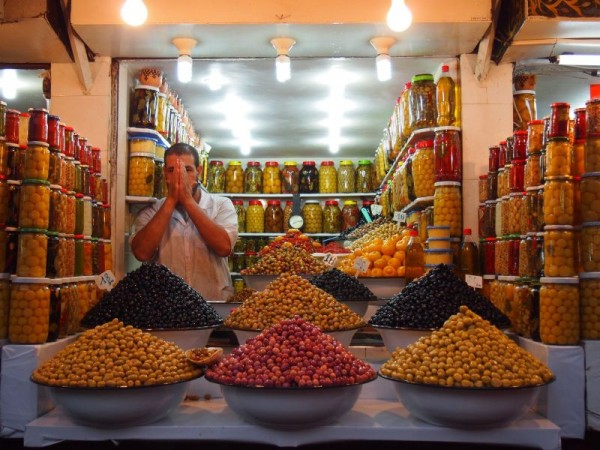 Pickled olive vendor in the souk of Medina Quarter, Red City Marrakech, Morocco