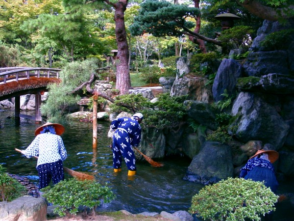 Sweeping the pond in the Kyoto Imperial Palace